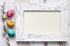 Easter eggs and empty vintage photo frame background Royalty Free Stock Photos