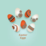 Easter Eggs in ethnic style on blue Royalty Free Stock Images