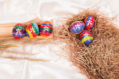Easter eggs on  fabric background Stock Images