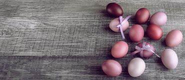 Easter eggs in fashionable colors on a gray wooden background.  royalty free stock photo