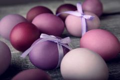 Easter eggs in fashionable colors on a gray wooden background.  royalty free stock images