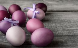 Easter eggs in fashionable colors on a gray wooden background.  Royalty Free Stock Photography
