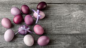 Easter eggs in fashionable colors on a gray wooden background.  Stock Photo