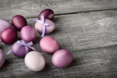 Easter eggs in fashionable colors on a gray wooden background.  Stock Image