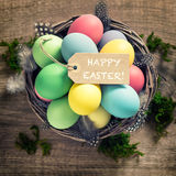 Easter eggs feather decoration and tag vintage style Royalty Free Stock Photography
