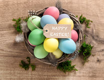Easter eggs with feather decoration and tag Royalty Free Stock Photo