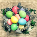 Easter eggs with feather decoration vintage toned Royalty Free Stock Photos