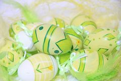 Easter eggs with feathers Stock Photos