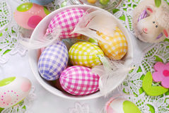 Easter eggs and feathers in bowl Royalty Free Stock Photos