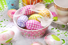 Easter eggs and feathers in bowl Royalty Free Stock Photography