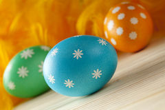 Easter eggs and feathers on wooden boards Royalty Free Stock Photo