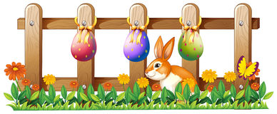 Easter eggs at the fence and a bunny Stock Photo