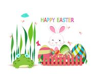 Easter eggs fence with spring bunny and frog Royalty Free Stock Images
