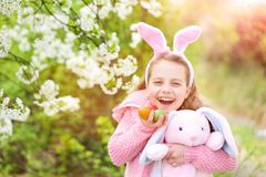 Fertility and rebirth concept. Easter eggs Fertility and rebirth concept. Easter and spring celebration. Childhood, youth and growth. Happy girl holding pink Royalty Free Stock Photo
