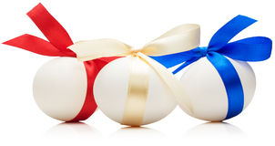 Easter eggs with festive bows isolated on white background Royalty Free Stock Photo