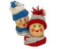 Easter eggs figurines. Photo of Easter eggs with face and woolen clothes stock photography