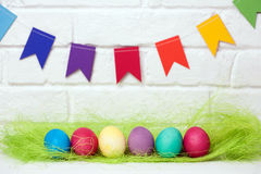 Easter eggs and flags. decoration for Easter holiday with easy DIY Easter flags. Do-it-yourself style selective focus. royalty free stock images