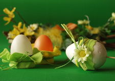 Easter eggs with flower decoration. Easter eggs, flower decoration, green background royalty free stock images