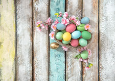 Easter eggs flower decoration Top view. Easter eggs with flower decoration on wooden background. Top view Royalty Free Stock Images