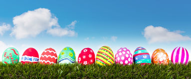 Easter Eggs with flower on Fresh Green Grass Stock Photos