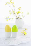 Easter eggs and flowering branches on wooden table. Easter composition with eggs and flowering branches on wooden table Royalty Free Stock Photography