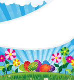 Easter eggs on a flowering meadow. Easter eggs with an abstract pattern on sunny flowering meadow Stock Photo