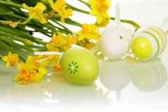 Easter eggs and flowers Stock Photos