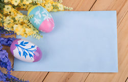 Easter Eggs and Flowers with Blank Envelope Royalty Free Stock Image