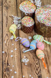 Easter eggs, flowers and cake Royalty Free Stock Photography