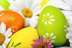 Easter eggs and flowers closeup Royalty Free Stock Photos