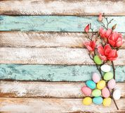 Easter eggs flowers decoration rustic wooden background. Easter eggs and flowers decoration on rustic wooden background royalty free stock image