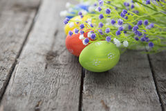Easter eggs and flowers frame background Stock Photo