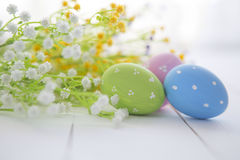 Easter eggs and flowers frame background Stock Image