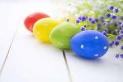 Easter eggs and flowers frame background Stock Images