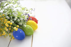 Easter eggs and flowers frame background Royalty Free Stock Photos