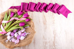 Easter eggs and flowers over white wooden table Stock Images