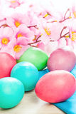 Easter eggs and flowers spring background Stock Photo