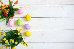 Easter eggs with flowers on white wooden background Stock Photos