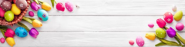 Easter Eggs with Flowers. On White Wooden Background royalty free stock photo