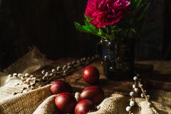 Easter eggs and flowers, willow branches stock images