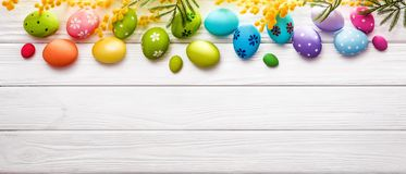 Easter Eggs with Flowers On Wood Background Stock Photos