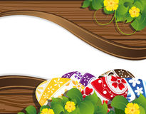 Easter eggs with flowers. Easter eggs on the wooden fence background with place for text Royalty Free Stock Photos