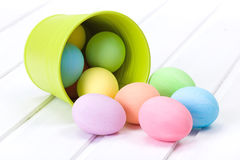 Easter eggs flowing out from bucket Royalty Free Stock Image