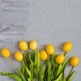 Easter eggs in the form of a bouquet of tulips on the table top made of artificial acrylic stone. The creative concept of the cele royalty free stock photos