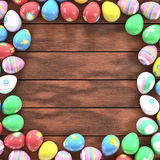 Easter eggs frame. Colorful Easter eggs on a table forming a frame Royalty Free Stock Photos