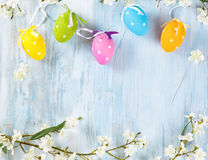 Easter eggs frame. Spring flowers and colorful Easter eggs frame Stock Image