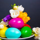 Easter eggs and freesia Royalty Free Stock Photography