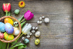Easter eggs and fresh spring tulips on vintage boards abstract background Stock Photo