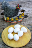 Easter eggs front of a hen. Stock Image