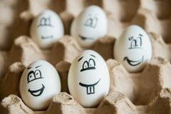 Two funny smiling eggs in a packet. Stock Image